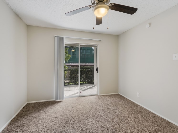 bedroom with carpet, and sliding doors to the balcony