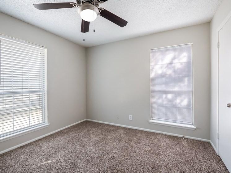 bedroom with long bedroom windows