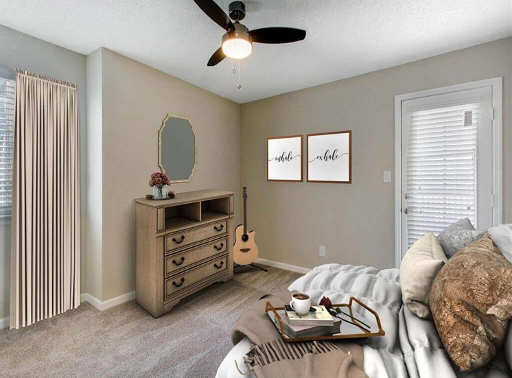 Bedroom with Door to Patio and Virtually Staged Furniture