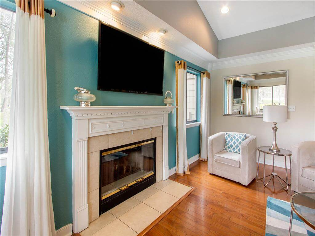 Clubhouse Seating Area Fireplace with TV Mounted Above it