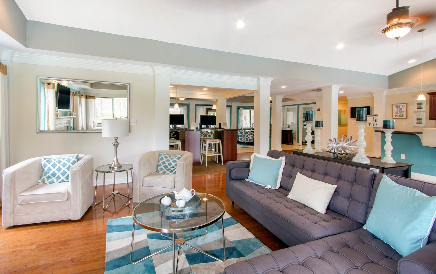 Clubhouse with two couches, two chairs, coffee table and decor