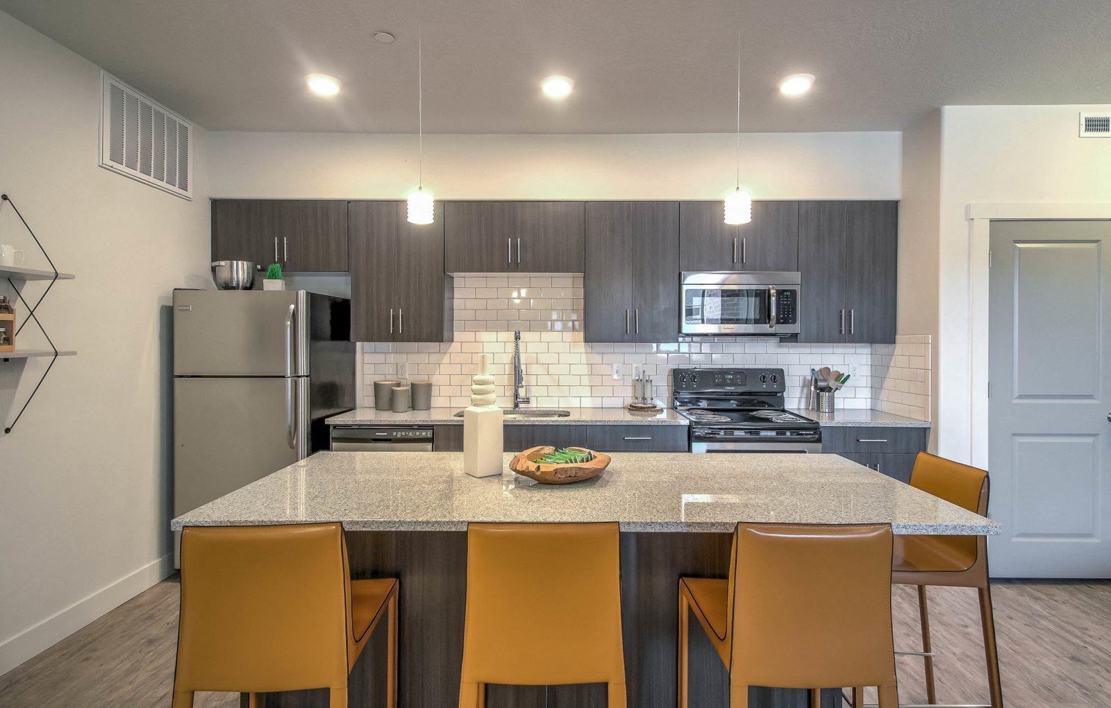 furnished model living room and kitchen