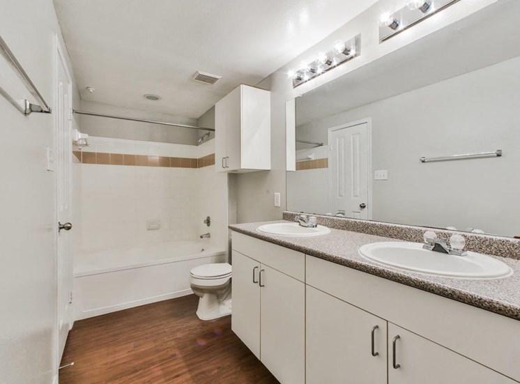 bathroom with wood flooring