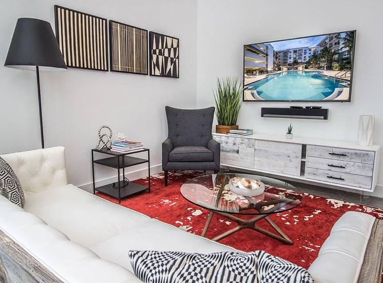 Santorini resident social room with lounge area and flatscreen tv
