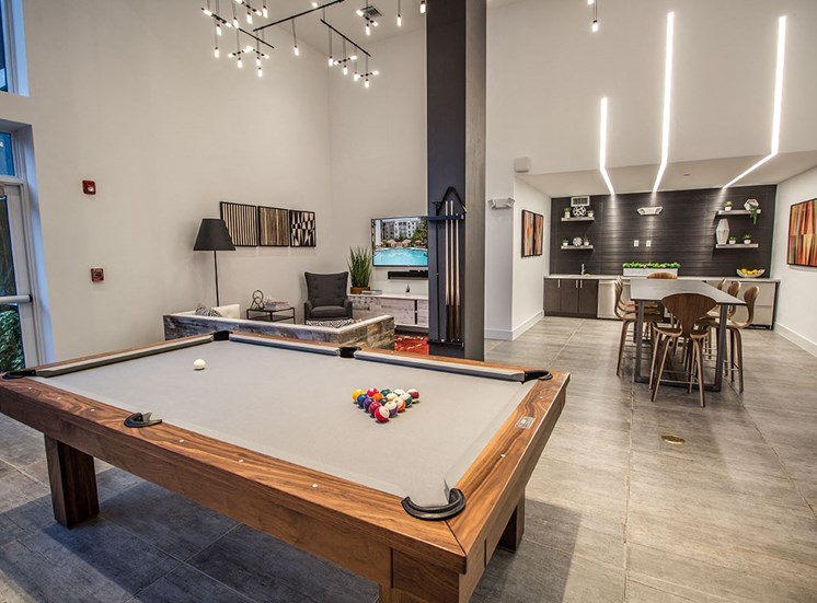 Santorini resident social room with billiards table, lounge area and kitchen