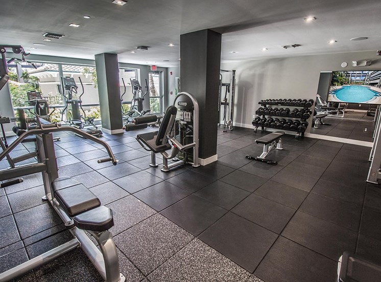 Fully equipped fitness center at Santorini apartments in South Florida