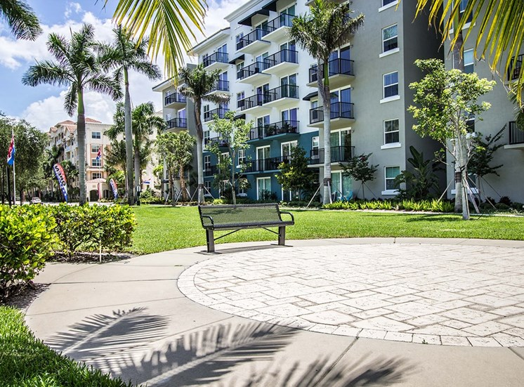 Santorini at Renaissance Commons features manicured grounds with palm trees