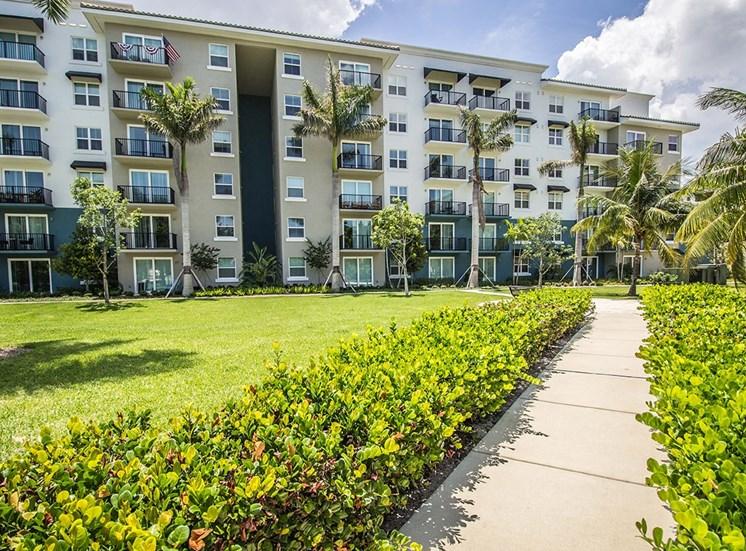 Manicured tropical landscaping at Santorini apartments in Boynton Beach