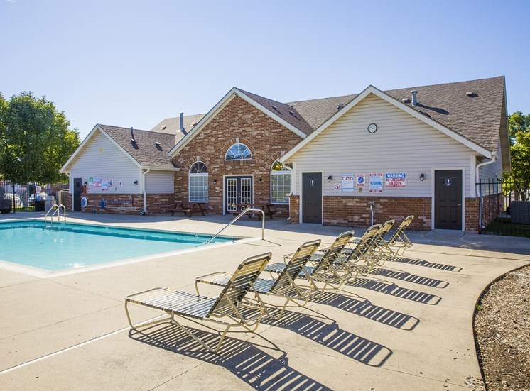 swimming pool and sundeck with lounge chairs
