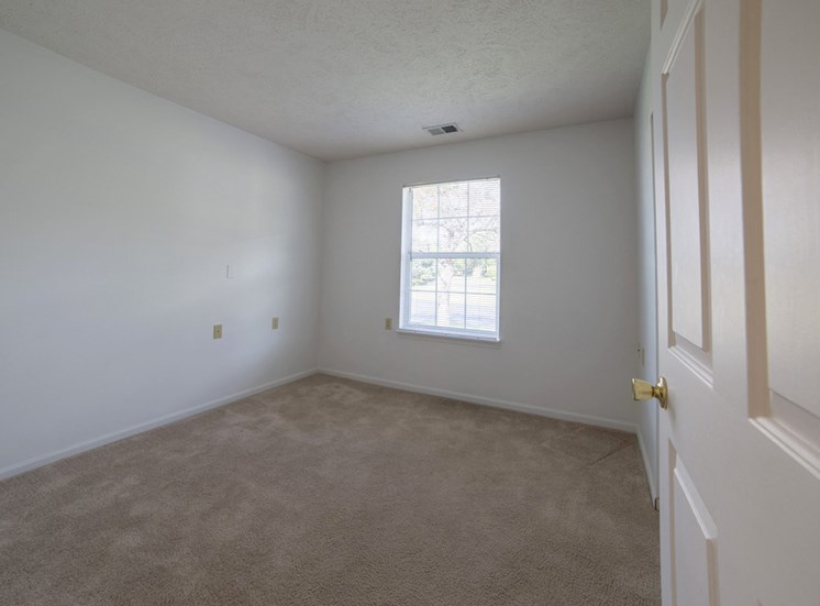 living room with carpet in apartment