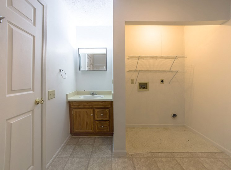 apartment with closet and sink