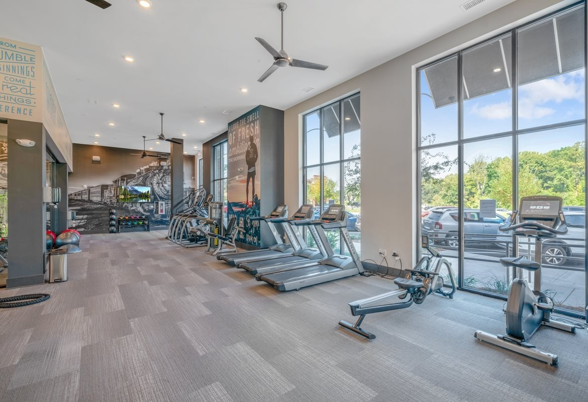 Pet Friendly Apartments in Cornelius, NC - The Junction at Antiquity Fully-Equipped Fitness Center with Cardio Machines, Free Weights, and Large Windows