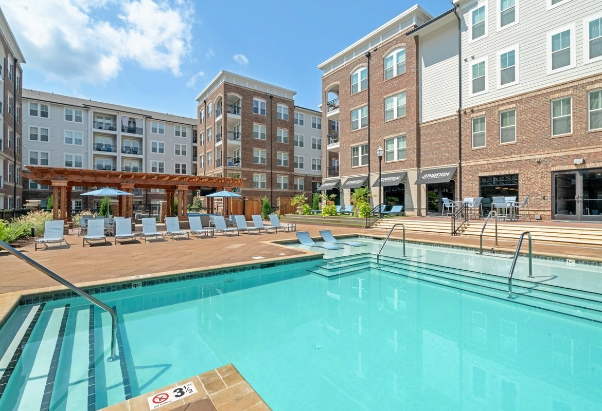 Cornelius, NC Apartments - The Junction at Antiquity Apartments Sparkling Pool with Lounge Chairs