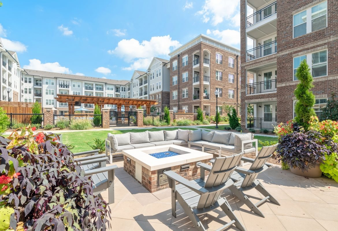 Apartments in Cornelius for Rent - The Junction at Antiquity Apartments Outdoor Lounge with Couches and Fireplace