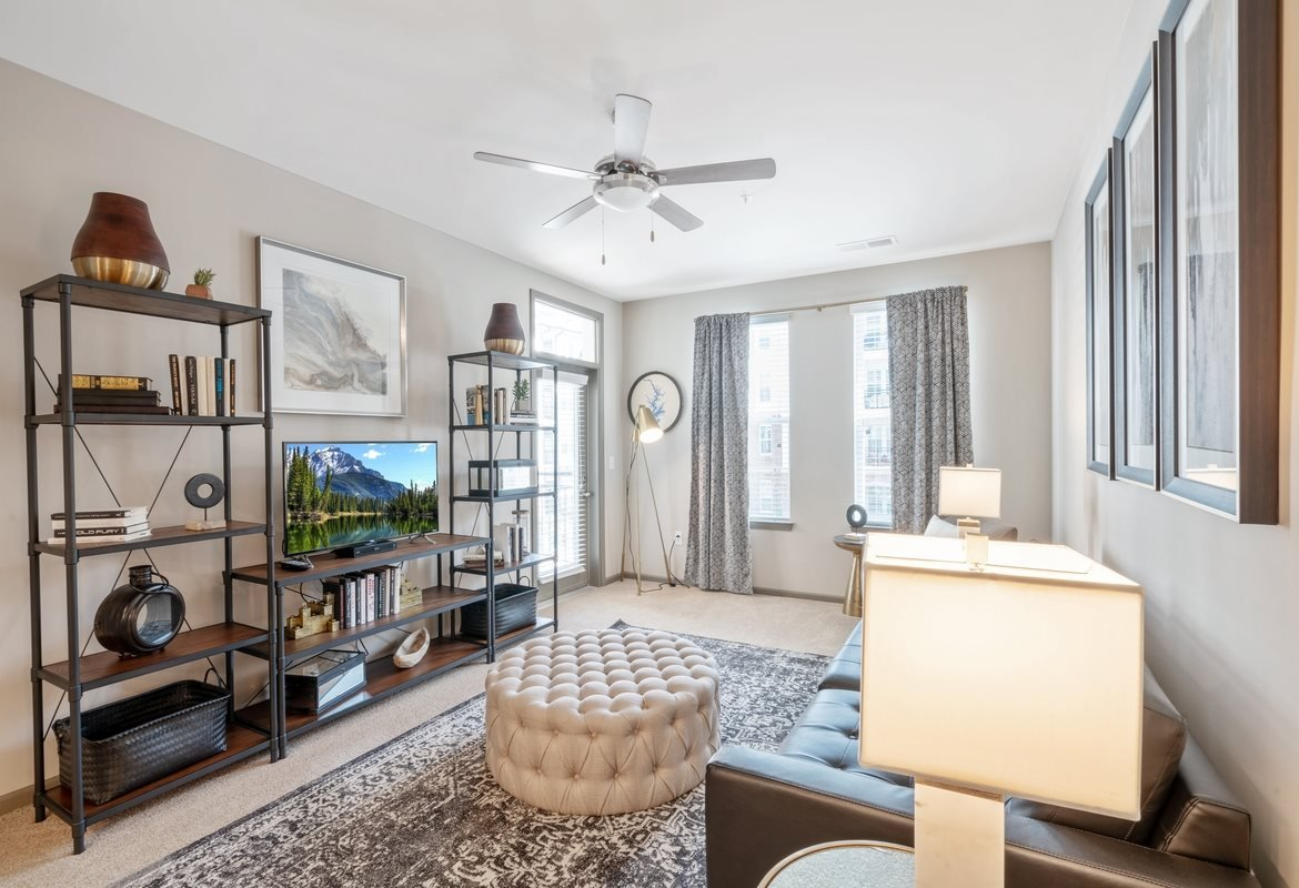 Pet Friendly Apartments in Cornelius, NC - The Junction at Antiquity Apartments Living Room with Ceiling Fan and Large Windows