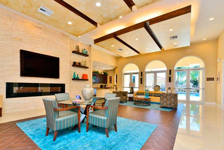 Stunning Modern Design Community Clubhouse with Ample Space and Amenities at Casa Brera at Toscana Isle Apartments, Lake Worth, FL 33463