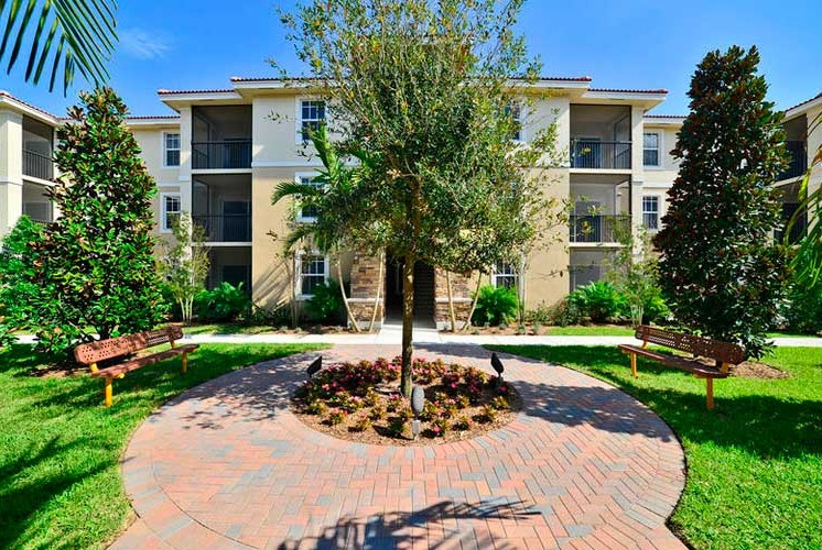 Meticulously maintained grounds with mature trees surround your apartment homes at Casa Brera at Toscana Isle Apartments, Lake Worth, FL 33463