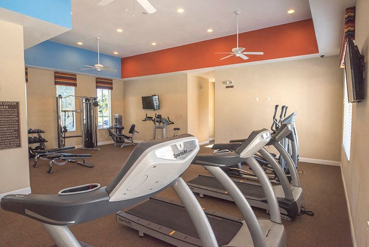 Health and Fitness Club including TVs, Boxing Studio, and Cardio and Weight Training at Casa Brera at Toscana Isle Apartments, Lake Worth, FL 33463