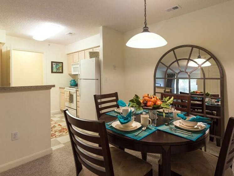Dining Area Near Kitchen at The Preserve Apartments in Walpole, MA