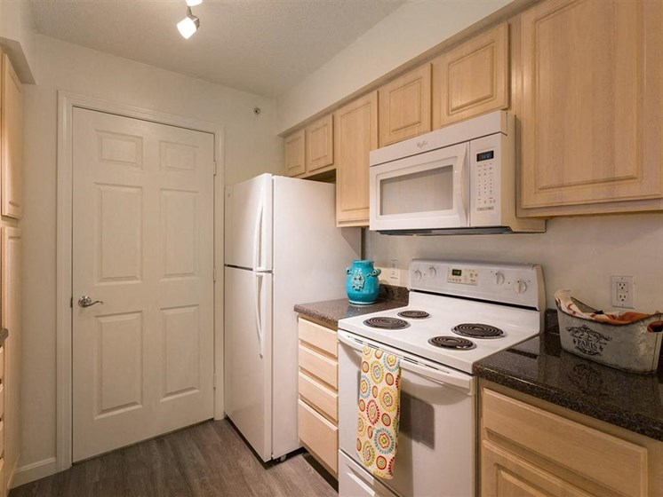 Fully-Equipped Kitchen With Tan Cabinetry at The Preserve Apartments, 100 Hilltop Dr, Walpole, MA 02081