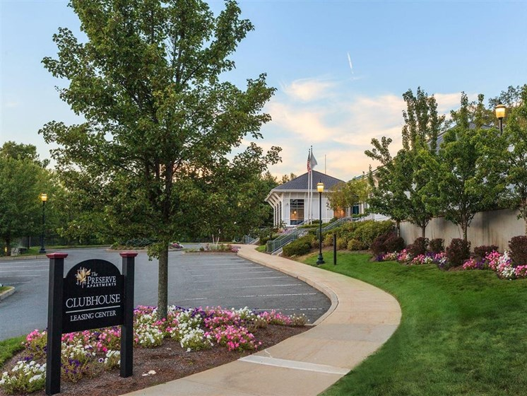 Front Entrance Sign With Landscaping and Walkway at The Preserve Apartments in Walpole, MA