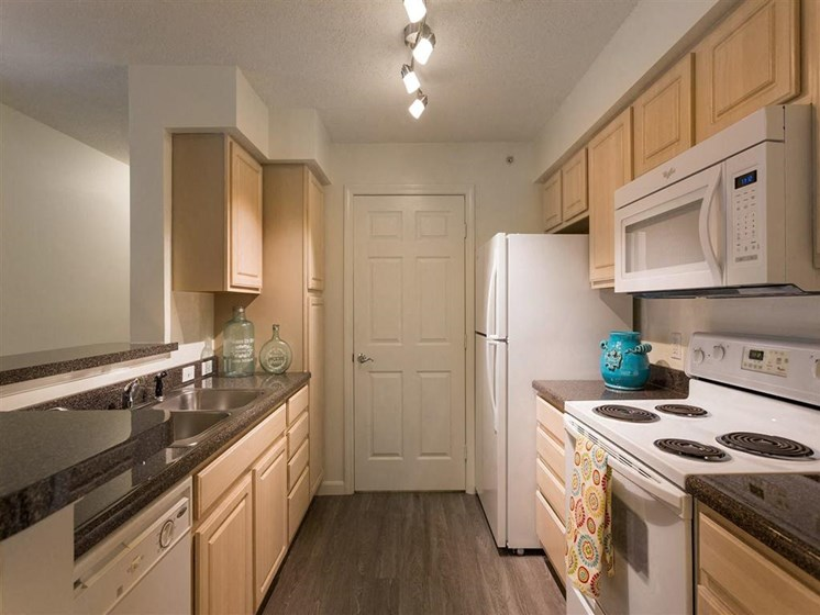 Kitchen With Wood Flooring and Tan Cabinetry at The Preserve Apartments near Walpole, MA 02081