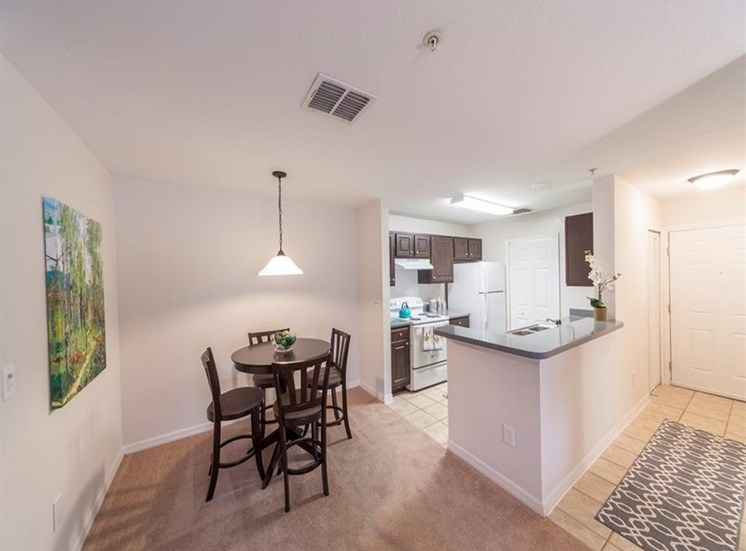 Furnished Model Dining Room and Kitchen