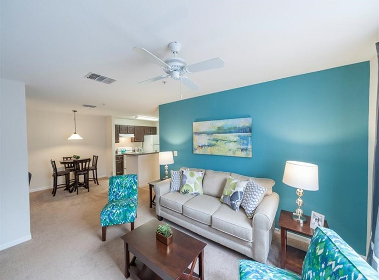 Furnished Model Living Room with Accent Wall