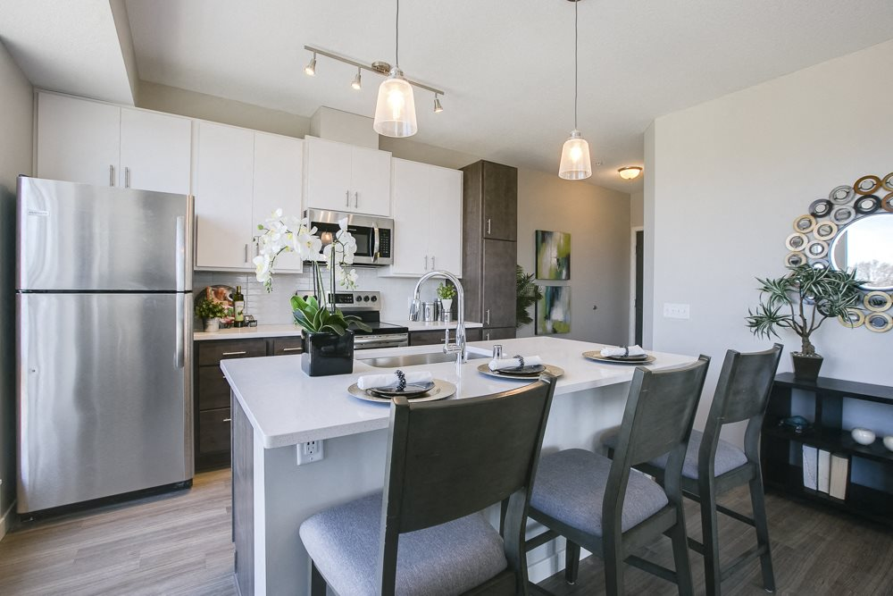 Kitchen with island and pendant lighting at The Central apartments near downtown Minneapolis MN 55408