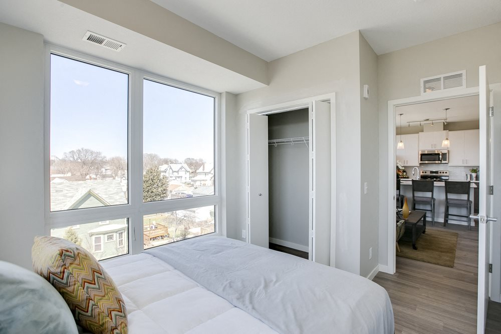 Bedroom with large windows at The Central apartments near downtown Minneapolis MN 55408