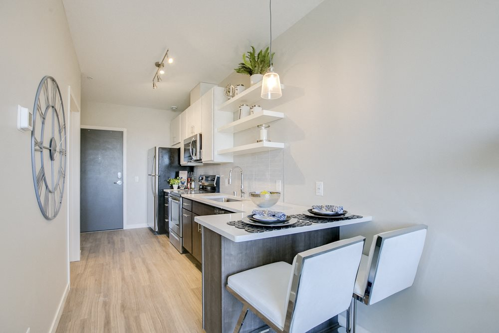 Studio kitchen with breakfast bar at The Central apartments near downtown Minneapolis MN 55408