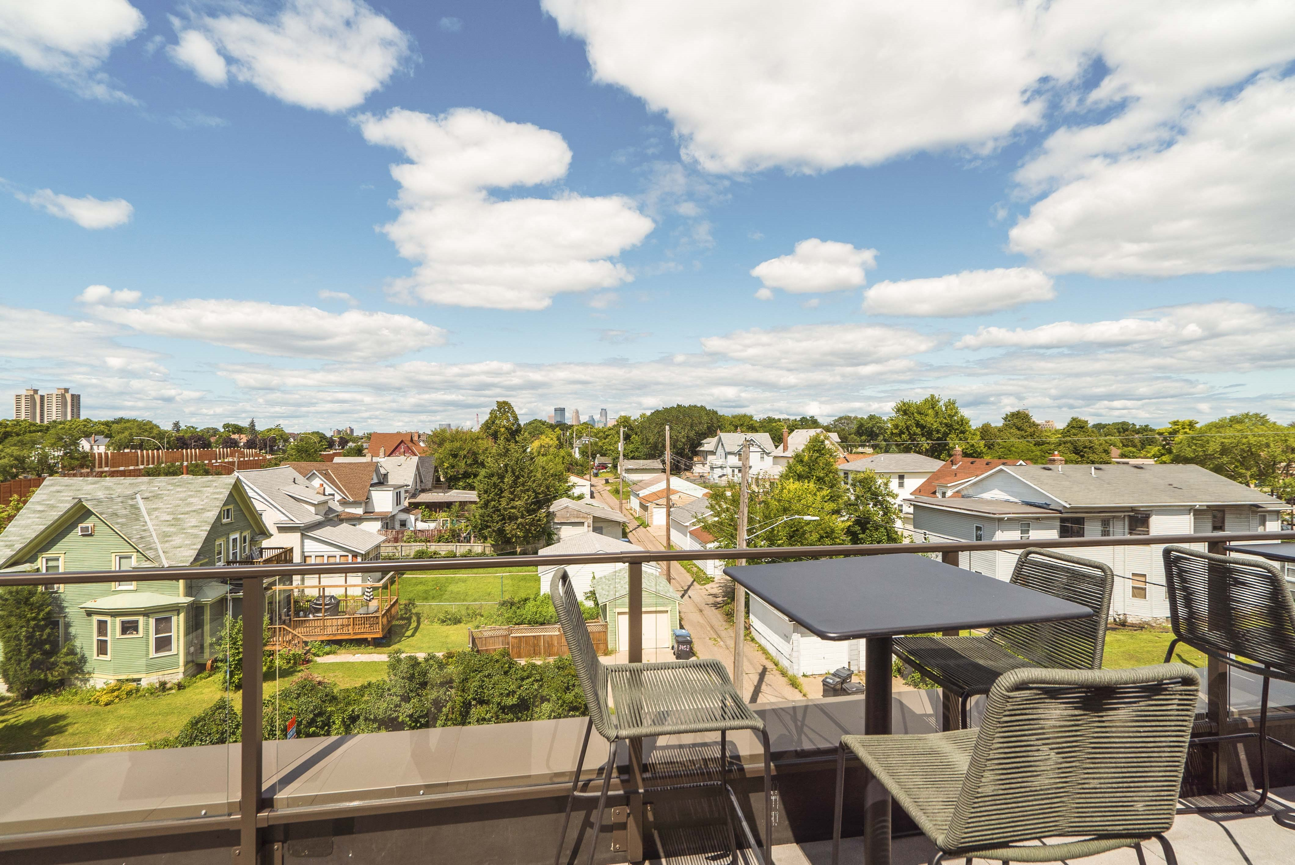 Scenic views from the rooftop patio and outdoor firepit at The Central apartments near downtown Minneapolis MN 55408