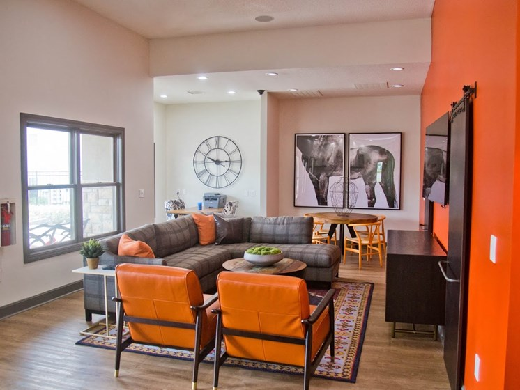 Posh Lounge Area In Clubhouse at The Manor Homes of Eagle Glen, Raymore, MO, 64083