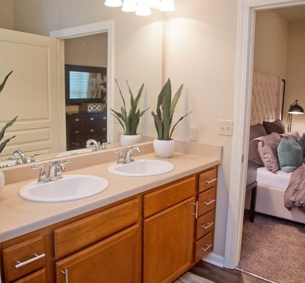 Well Appointed Bedroom at The Manor Homes of Eagle Glen, Raymore, MO