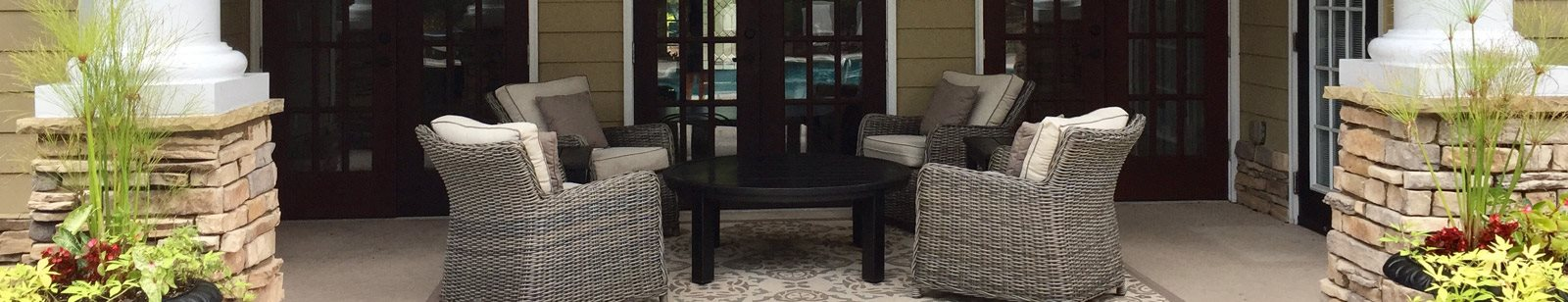 Gorgeous outdoor patio area with conversational seating area at Legends at Charleston Park Apartments, North Charleston, SC, 29420