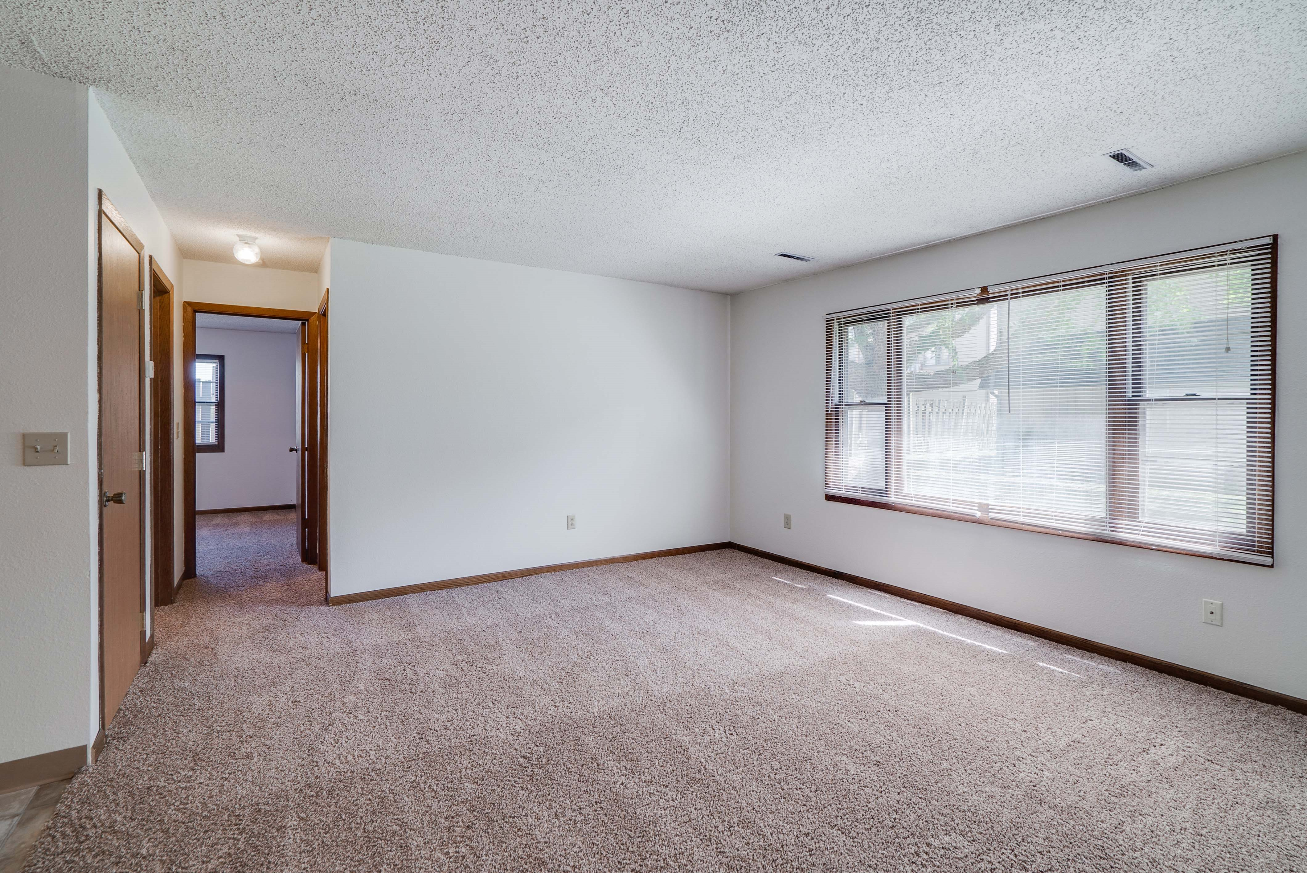 Living space with large windows providing lots of natural light at South View Apartments