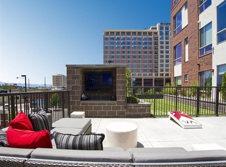 Rooftop lounge with fire place, lounge seating, overlooking city