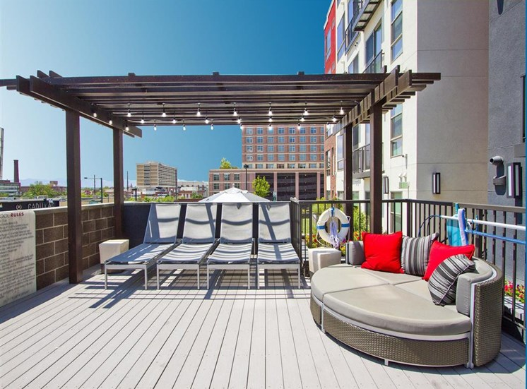 Rooftop Lounge chairs under a gazebo with large lounge couch