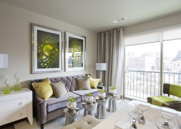 Model Living Room with Contemporary Furniture, green living room and wall decor