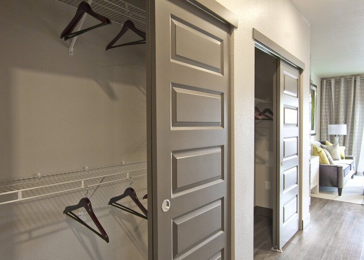 Closet with shelving and clothes hangers