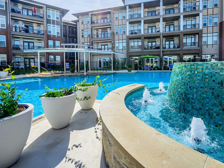 Discover an Apartment Home that Overlooks this Stunning Resort-Inspired Swimming Pool