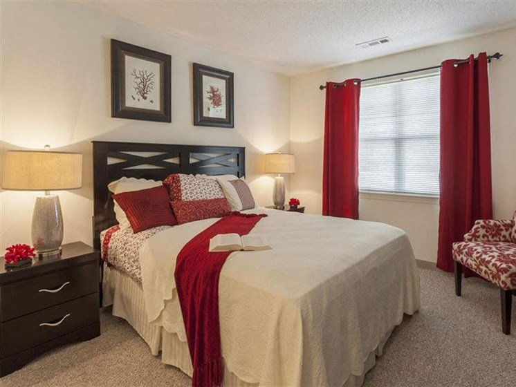 Master Bedroom With Carpeted Flooring at Quail Run Apartments in Stoughton, MA
