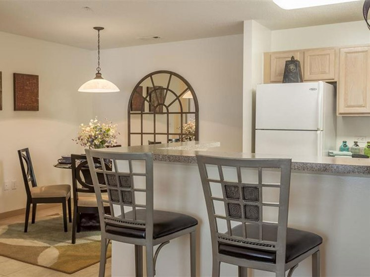 Kitchen Counter With Chairs at Quail Run Apartments in Stoughton, MA
