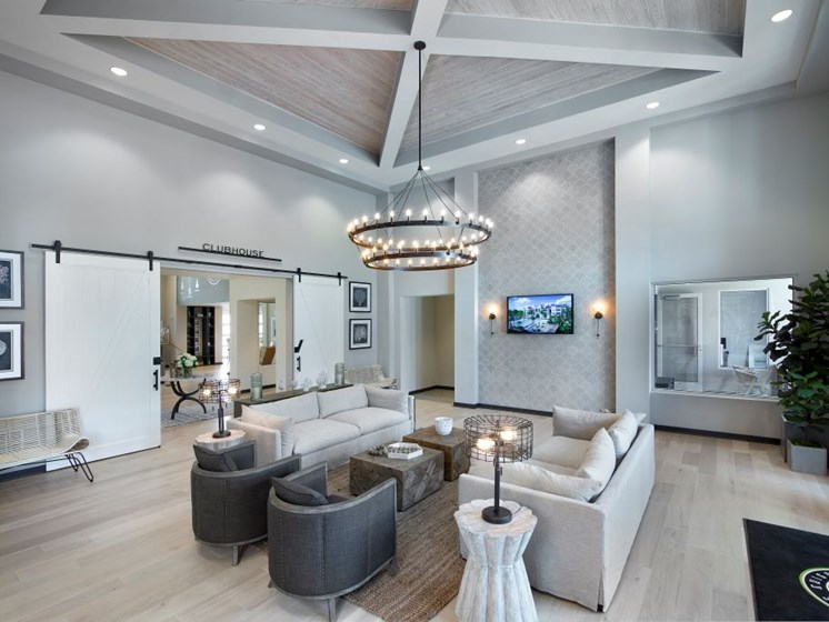 Lounge seating and amble entertains space in our new Clubhouse at The Edison Apartments in Fort Myers, FL 33905