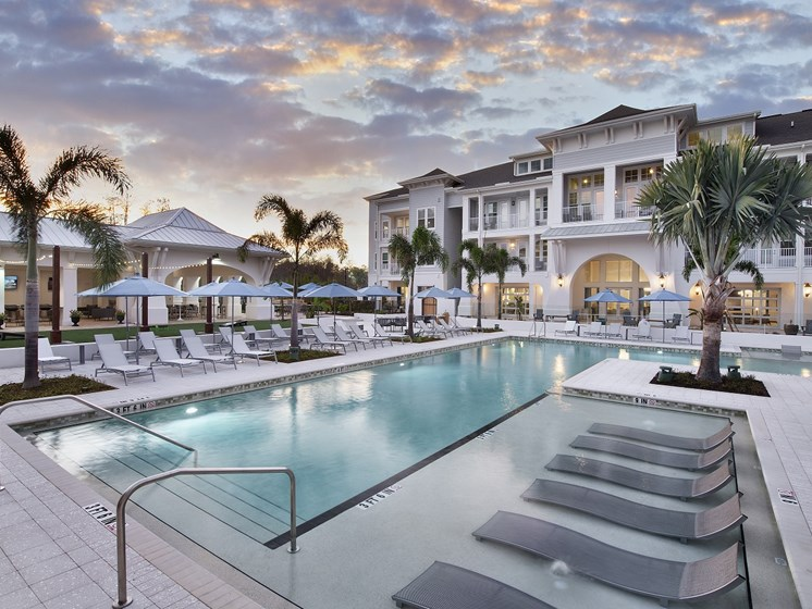 Resort Style Saltwater Pool with Tanning Ledge & Sun Loungers at The Edison Apartments, Fort Myers, FL 33905