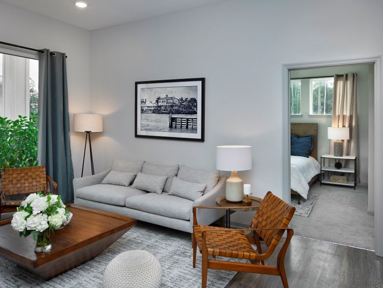 Large Open Floorplans with Ceiling Fans in Living and Bedroom Areas at The Edison Apartments in Fort Myers, FL 33905