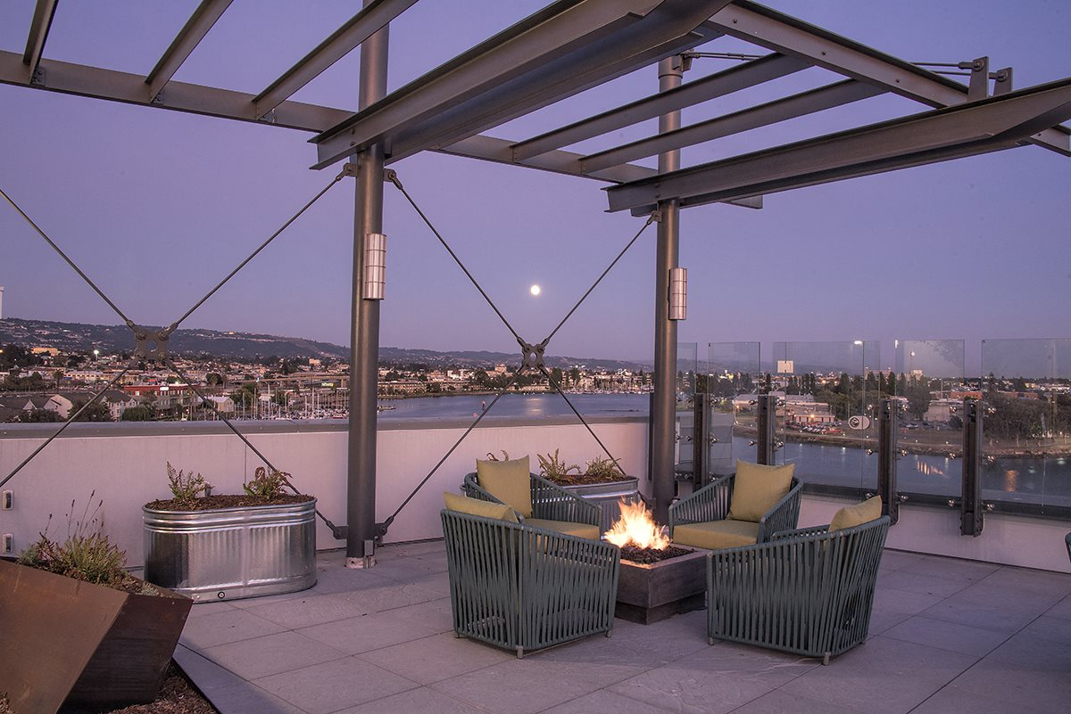 Rooftop seating with firepit  l Orion Apartments in Oakland