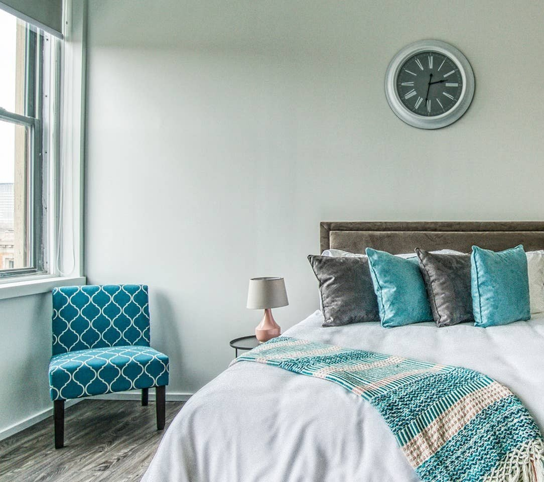 Bedroom With Expansive Windows at Market District Lofts, Ohio, 44113