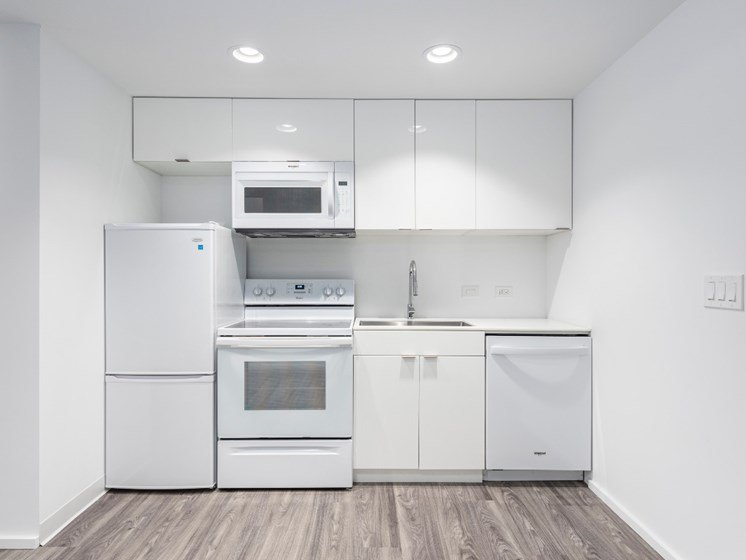 Kitchen With White Cabinetry And Appliances at Market District Lofts, Cleveland, OH