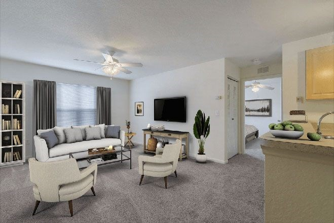 Carpeted Living Room with Virtually Placed Couch, Armchair, Entertainment Center, Breakfast Bar and Decorations